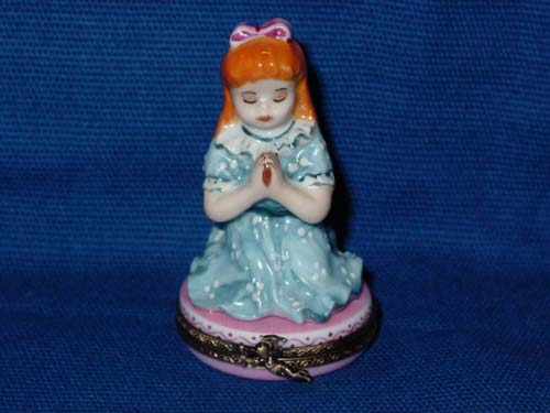 RED-HAIRED GIRL PRAYING
